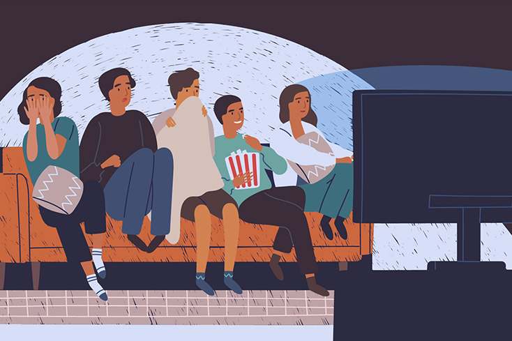 people on couch watching scary movie